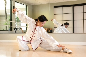 Tai chi lessons pose in front of mirror